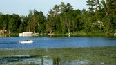 бас : Fishing boat on Big Turtle Lake in northern Minnesota near Bemidji on sunny evening Стоковые видеозаписи