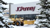penny : BEMIDJI, MN - 27 DEC 2018: JC Penney Retail Mall Location during a winter snow storm. JCP is an Apparel and Home Furnishing Retailer. Customers and snow plow can be seen.