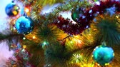focus : Creative abstract Christmas, Xmas and Mew Year winter holidays celebration concept: macro view of colorful decorated Christmas Tree with shiny metallic balls and color electric garland lights