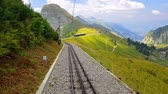 Scenic summer view of the cogwheel railway on the way down from Rochers de Naye mountain peak in Switzerland