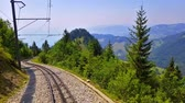 Scenic summer view of the cogwheel railway on the way to Rochers de Naye mountain peak in Switzerland Dostupné videozáznamy