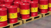 produção : Creative abstract oil and gas industry manufacturing and trading business concept: 3D render video of the group of the industrial storage warehouse with a stacked rows of red metal oil drums or petroleum barrels with selective focus effect