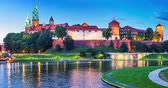 krakow : Scenic summer night view of the Wawel Castle, Cathedral Church and Vistula river embankment in the Old Town of Krakow, Poland