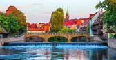 Scenic summer view of the bridge over Pegnitz River in sunset in the Old Town of Nurnberg, Bavaria, Germany