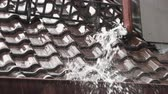 gutter system : rainwater beats from the drainpipe. Stock Footage