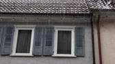 water curtain : window shutters at home in the rain in germany