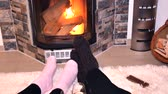 сочельник : Lovers drink white wine in front of the fireplace