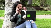listening : Brunette on the grass with a computer