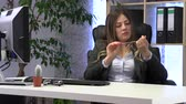 pedicure : female manager files her nails at the workplace Stock Footage