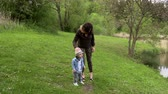 park : Mom walks with her little son