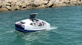hovercraft : white amphibious car floating in the mediterranean sea