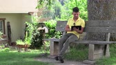 portátil : A young teenager with a tablet computer chatting. Stock Footage