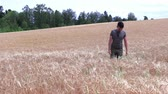 Portrait of a young man in a wheat field