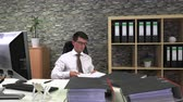 cansado : tired office worker to sort documents Stock Footage