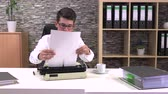 gazetecilik : accountant writes on a typewriter at a table in the workplace