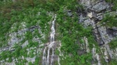 AERIAL VIEW:camera moves along the waterfall.Triglav National Park.flight around Bohinj lake Stock mozgókép