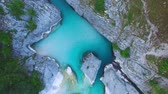 AERIAL top down view: flight over mountain river Soca. Camera moves from down to top