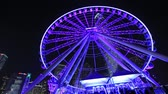структура : Ferris Wheel in Hong Kong at night.