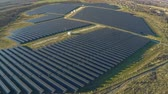 solar energy power : AERIAL industrial view Photovoltaic solar panels producing renewable energy Stock Footage