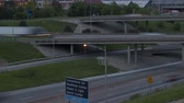 intersection : KANSAS CITY, MISSOURI, USA - MAY 17, 2014: Time lapse extreme close up tilt and pan shot from traffic to the skyline on the Highway Intersection in Kansas City at twilight
