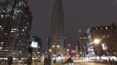 timelapse : NEW YORK CITY, USA - MAR 13, 2014: 4K Time lapse zoom out of traffic at night at the crossing next to Flatiron Building in New York at 5th Avenue with Taxis rushing by. Stock Footage