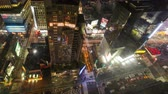 NEW YORK CITY NOV 14-2010: 4K Timelapse aerial view of Times Square, a busy traffic intersection with neon art. Times Square is one of the most iconic places in New York City. Стоковые видеозаписи
