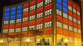 INDIANAPOLIS, USA - July 09 2014: 4K Timelapse zoom out Indianapolis office building with the american flag lighting and traffic passing by