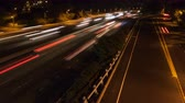4K Time lapse speed traffic light trails wideangle on highway motorway at night with urban background Stok Video