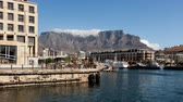 CAPE TOWN, SOUTH AFRICA - MAR 16, 2010: 4K Time lapse wideangle Clouds over Table Mountain at daytime with Victoria and Alfred Waterfront on a sunny day