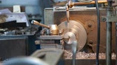 production of parts on a lathe. close-up. 動画素材