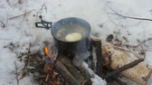 tourism, fish soup is cooked at the stake in a hike