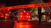 Police tape and flashing lights of fire engines at night emergency, Utah.