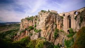 sol : Ronda, Spain cliffside view of Puente Nuevo Bridge. Stock Footage