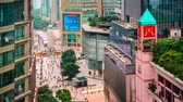 kurtuluş : CHONGQING, CHINA - MAY 30, 2014: People stroll through the Jiefangbei CBD pedestrian mall. The district is considered the most prominent financial district in the interior of China. Stok Video