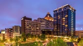 manzara : Greensboro North Carolina USA downtown skyline time lapse at twilight.