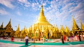 dagon : YANGON, MYANMAR - OCTOBER 17, 2015: Early morning worshipers at Shwedagon Pagoda. It is the holiest shrine in Myanmar and one of the most well known Buddhist Temples in the world.