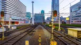 коммутирующих : OSAKA - AUGUST 17, 2015: Hankyu Railway trains enter and exit Umeda station. It is considered the busiest station in Western Japan. Стоковые видеозаписи