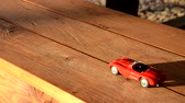 Toy car travels on a bench