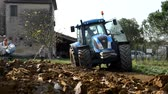 Pisa, Italy - October 6, 2017: Tractor moves between the clods