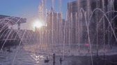 morning glory : urban landscape with a fountain at sunset