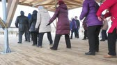 sibirya : KRASNOYARSKRUSSIA - March 30, 2018: older people play outdoor games in the Park in winter Stok Video