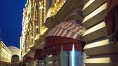 luz frontal : Facade of a building is decorated with illuminations. Canopies over shop windows