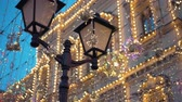 hanglamp : Street lamp, Christmas decorations, garlands, a large number of glowing lights