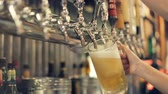 Pouring Perfect Draft Beer. A beer tap is a valve, specifically a tap, for controlling the release of beer. Stok Video