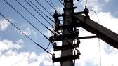 distances : Utility pole and power lines in the blue sky Stock Footage
