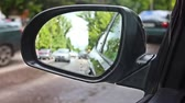 roket : URYPINSK, RUSSIA - JUNE 23, 2017: Reflection in the rearview mirror of a car Stok Video