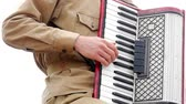 összhang : Musician playing the accordion. Hand playing accordions closeup. Accordion player.