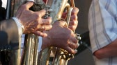 valves : Trumpets in the hands of the musicians in the orchestra. Hands of the man playing the trumpet.