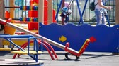 улыбки : Active children playing on a playground