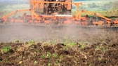 cultivating : Agricultural tractor sowing and cultivating field. Tractor working in the field at sunset. Stock Footage